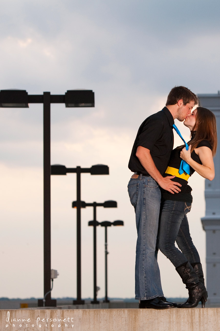 Engagement photos with a city/urban feel in Charlotte on parking deck