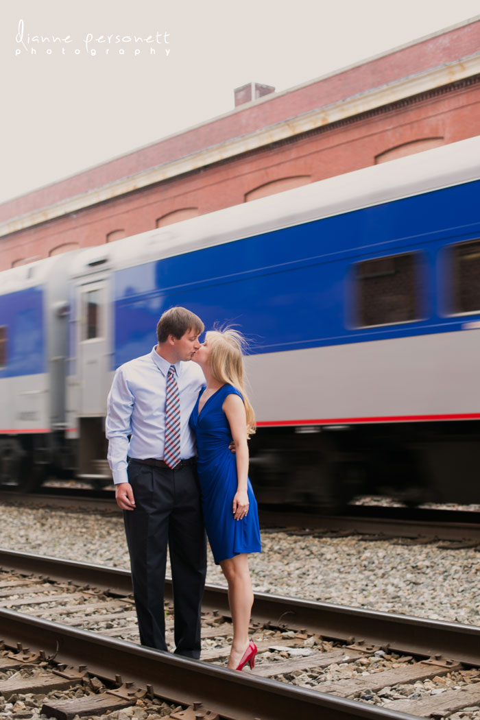 downtown Greensboro NC engagement photos with train tracks