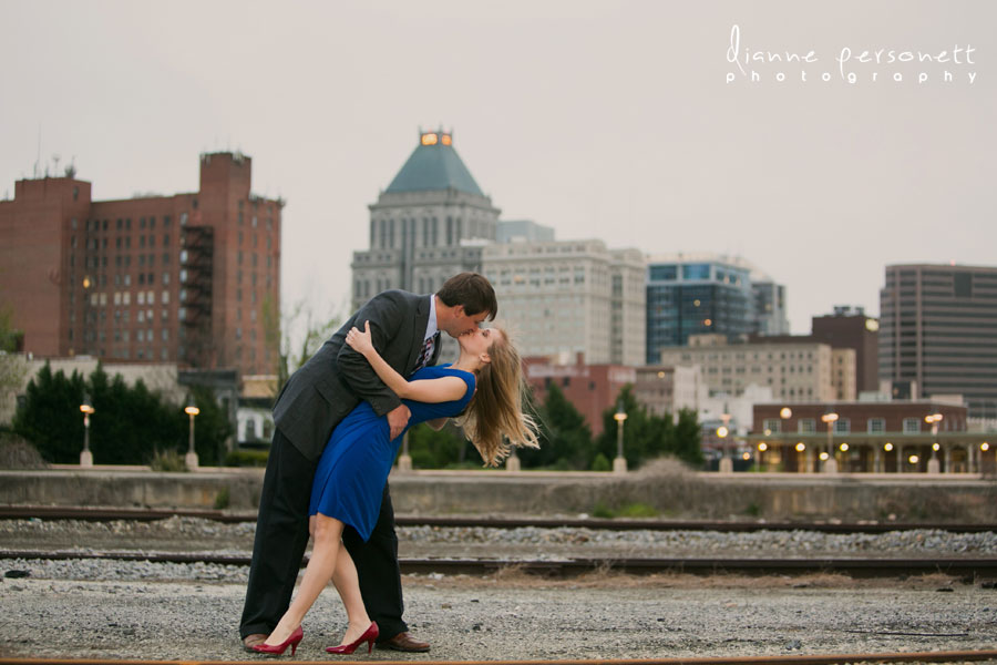 downtown greensboro skyline engagement photos