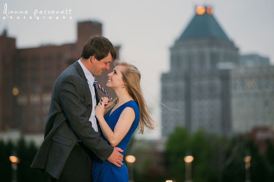 downtown greensboro nc engagement photos with greensboro skyline